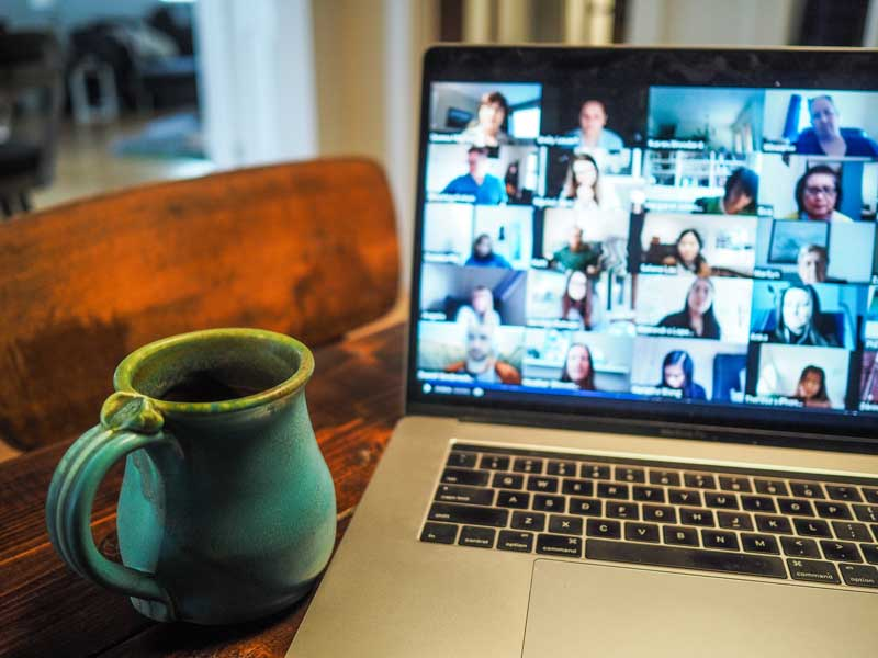 Picture of a coffee cup and online meeting