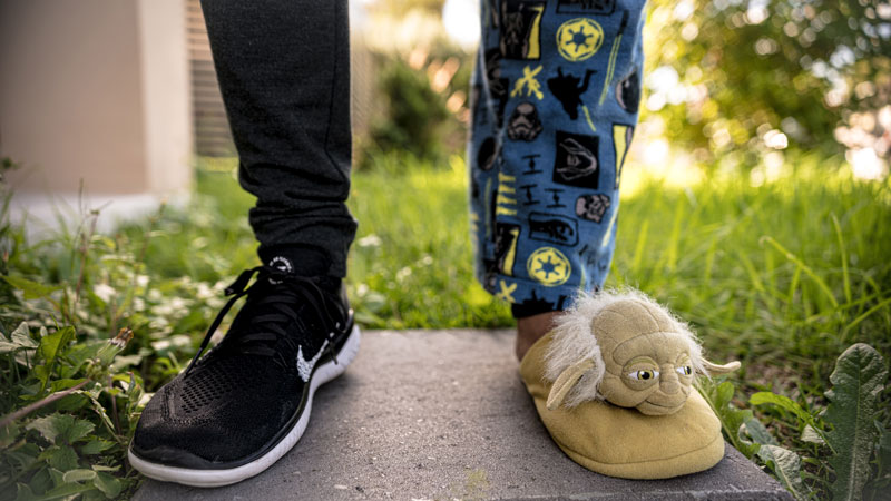 Picture of legs with one tennis shoe and one slipper