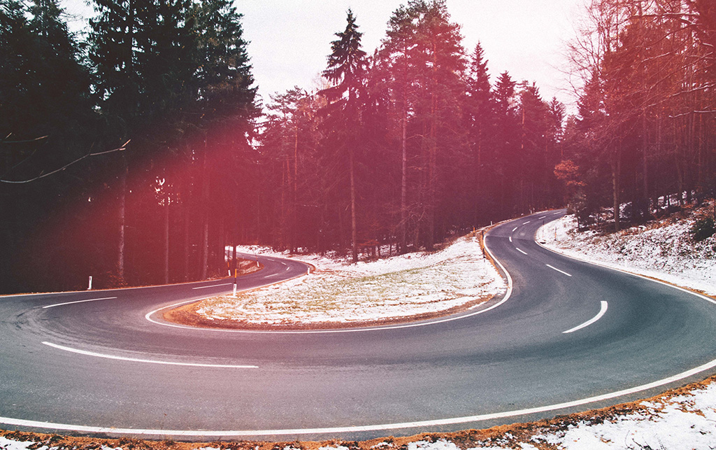 Photo of a curvy road at sunrise