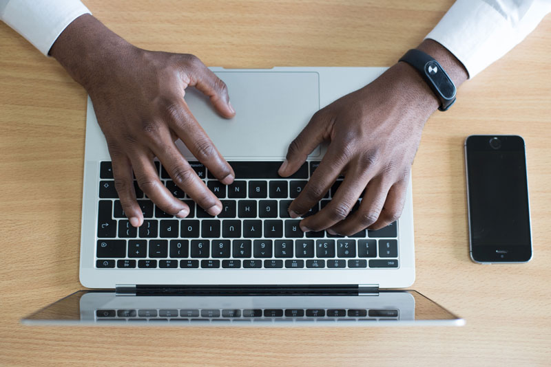 Hands-typing-on-a-laptop