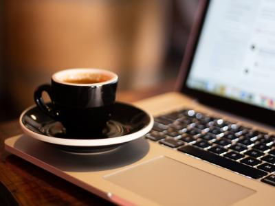 Coffee cup on Laptop