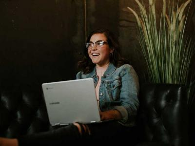 Image of smiling woman on laptop